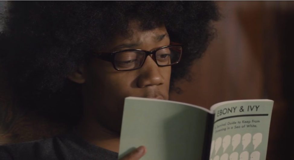 Queer college student Lionel Higgins (Tyler James Williams) reading Ebony and Ivy in Justin Simien's film Dear White People (2014)